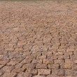 Granite brick road natural stone background close up — Stock Photo