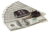US dollars and car key and alarm isolated on white background — Stock Photo