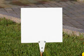 Empty sign on the grass — Stock Photo
