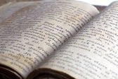 Old opened book, selective focus, isolated on white — Stock fotografie