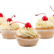 Set of cup cakes with red cherry isolated on white background — Stock Photo #21415781