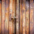 Old padlock on rusty garage collars — Stock Photo