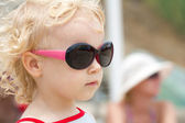 Little two ears girl in fashionable sunglasses — Stock Photo