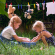 Girls are washing toys — Stockfoto