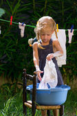 Girl is washing clothes — Stock Photo