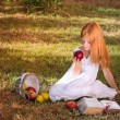 Girl with apple — Stockfoto #13617364