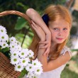 Girl with flowers — Stock Photo #13617973