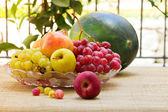 Fruit plate and watermelon — Stock Photo