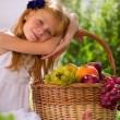 Stock Photo: Girl and fruit basket