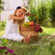 Girl and fruit basket — Stock Photo