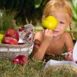 Stock Photo: Girl and basket of apples
