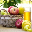 Stock Photo: Basket of apples and glass