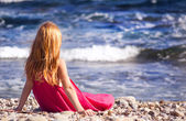 Girl sitting on the beach — Stock Photo