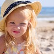 Stock Photo: Girl on beach wearing hat