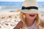 Girl on the beach wearing a hat — Stock Photo
