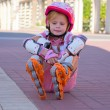 Royalty-Free Stock Photo: Girl sitting on roller skates