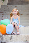 Girl with balloons — Stock Photo
