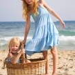 Stock Photo: Girls on beach with basket
