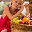 Girl and fruit — Stock Photo