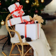Stock Photo: Gifts on chair