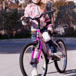 Girl with a bicycle — Stock Photo