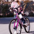 Girl with a bicycle — Stock Photo #15766073