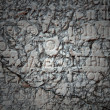 Stock Photo: Greek inscription carved in stone at ancient ruins