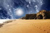 A walk along sand beach and rocks — Stock Photo