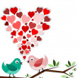 Birds in love on branch with heart above them — Stock Photo #13389143