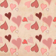 Abstract seamless background with different colored hearts in grunge style — Stock Photo #13389381