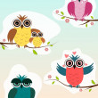 4 different owls sitting on a spring branch with different emotions - Stock Photo