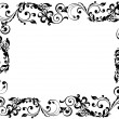 Black floral and swirly picture frame — Stock Photo #13410221
