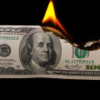 Stock Photo: Burning dollars