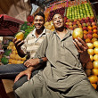 Fruit sellers in the market in Egypt - Stock Photo