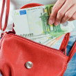 Stock Photo: Euro banknotes in hand of girl
