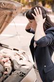 Woman near the broken car — Stock Photo