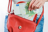 Euro banknotes in a hand of the girl — Stock Photo