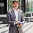 Businessman writes ideas in a notebook — Stock Photo