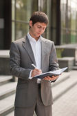 Businessman with a notebook — Stock Photo