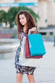 Ragazza con borse della spesa — Foto Stock