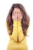 Frightened girl hiding her face — Stock Photo