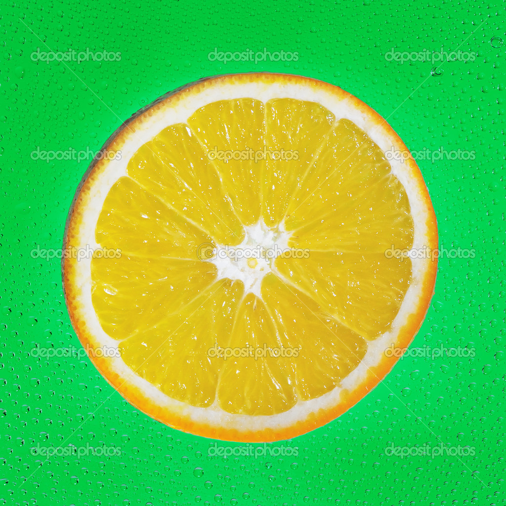 Slice of orange on green drop  background  Stock Photo #18769507