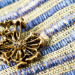 Stock Photo: Brooch on fabric