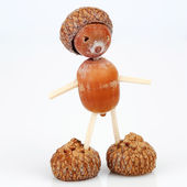 Figure made of acorns and matches — Stock Photo