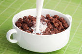 Breakfast cereals, chocolate balls with milk — Stock Photo