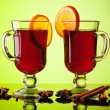 Stock Photo: Mulled wine in two glasses on green