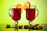 Mulled wine in two glasses on green — Stock Photo