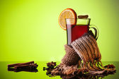Mulled wine and scarf on green — Stock Photo
