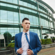 Young stylish businessman near office building — Stock Photo