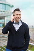 Portrait of a young businessman talking on phone — Stock Photo